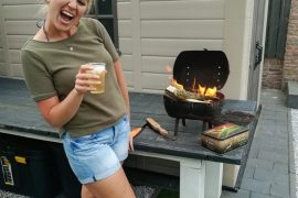 Blonde girl standing next to fire
